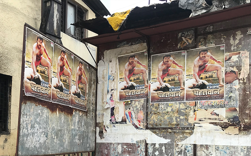 Posters of Loha Pahalwan at Royal Talkies. Not pictured: a row of undergarments hanging out to dry just below.